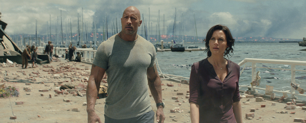 """Dwayne """"The Rock"""" Johnson and Carla Gugino star in the thriller """"San Andreas."""" The film earned an estimated $53.2 million over the weekend."""