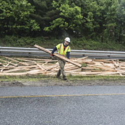 PORTLAND, ME - JUNE 1: Crews clean up lumber in the median between the north and southbound lanes of 295 after a truck spilled its contents in Portland, ME  on Monday, June 1, 2015. (Photo by Whitney Hayward/Staff Photographer)