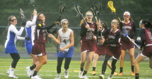 Falmouth's Olivia Stucker, 4, breaks away from a pack of players during the Yachtsmen's 15-6 win over Freeport on Monday in Falmouth.