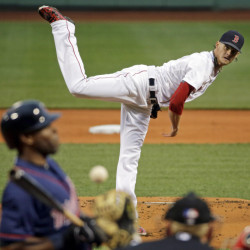 The Twins' Torii Hunter leans back from an inside pitch by Red Sox starter Clay Buchholz in the first inning Tuesday night at Fenway Park. Buchholz got his first win in more than three weeks, giving up just three hits in eight innings.
