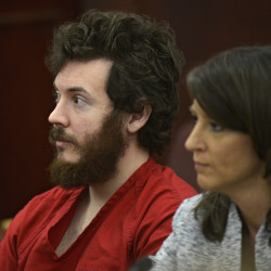 James Holmes and his defense attorney appear in court in March. Prosecutors are building a case that he knew right from wrong when he carried out the deadly Colorado theater shooting, hoping to convince jurors that he should be convicted and not sent to a psychiatric  hospital.