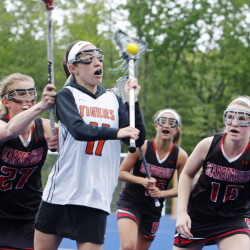 Cassidy Petit of Biddeford is surrounded by Kaitlin Prince, left, Ellie Smith, center, and Alex McCown of Scarborough during the first half of Scarborough's 13-6 victory in a girls' lacrosse game Tuesday at Biddeford.