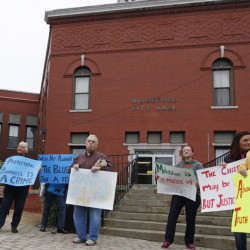 Supporters of victims of alleged sexual abuse by former Biddeford police officers picket before Tuesday night's City Council meeting at City Hall. Jill Brady/Staff Photographer