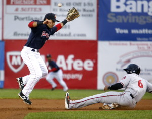 Carlos Asuaje of the Sea Dogs avoids Richmond's Daniel Carbonell as a throw sails wide during the fourth inning Tuesday night at Hadlock Field. Richmond held on for the 4-3 win.