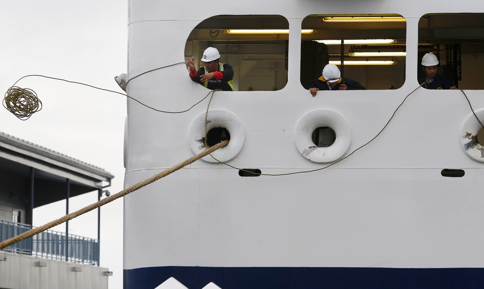 Crewmen work to secure the Nova Star as it arrives in Portland from Yarmouth, Nova Scotia, on Tuesday. The ship gets its provisions almost exclusively from Canadian vendors this year, a flip-flop from its inaugural season last year, when Portland was effectively its home port.