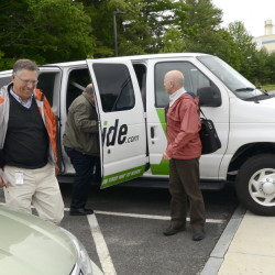 An Idexx commuter van drops its passengers in Westbrook. It's one of several Maine businesses that give incentives for carpooling.