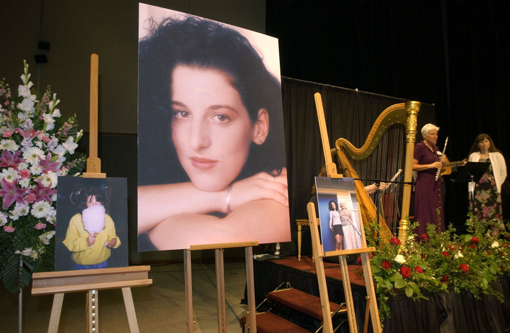 Photos of Chandra Levy are displayed in Modesto Centre Plaza in Modesto, Calif., at the 2002 memorial service for the Washington intern killed in 2001.