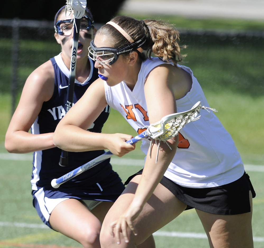 Isabella Munro of North Yarmouth Academy attempts to gain position for a shot while Campbell Dorsett of Yarmouth defends. Yarmouth ended the regular season with an 8-4 record. NYA finished at 1-11.