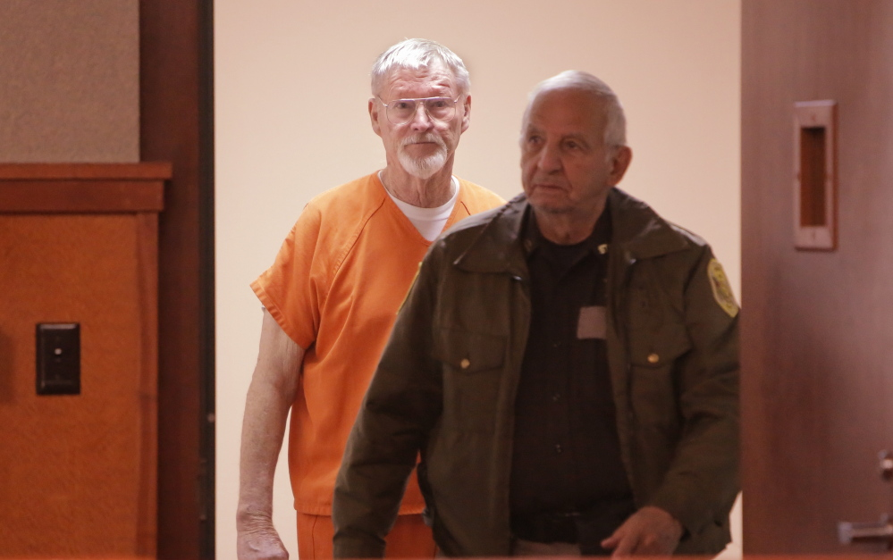 "Merrill ""Mike"" Kimball enters the courtroom Friday for sentencing in the shooting death of Leon Kelley."