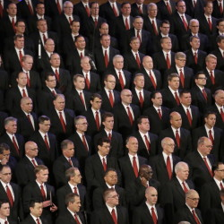 Members of the Mormon Tabernacle Choir look on during the public funeral for L. Tom Perry, a member of The Church of Jesus Christ of Latter-day Saints' highest governing body, Friday in Salt Lake City, Utah.