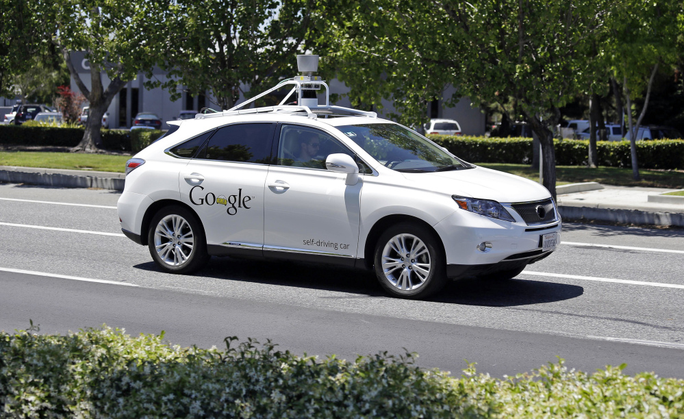 Google says six accidents happened with its self-driving cars while the cars were in autonomous driving mode. The other six happened while staffers were driving. 2014 Associated Press file photo