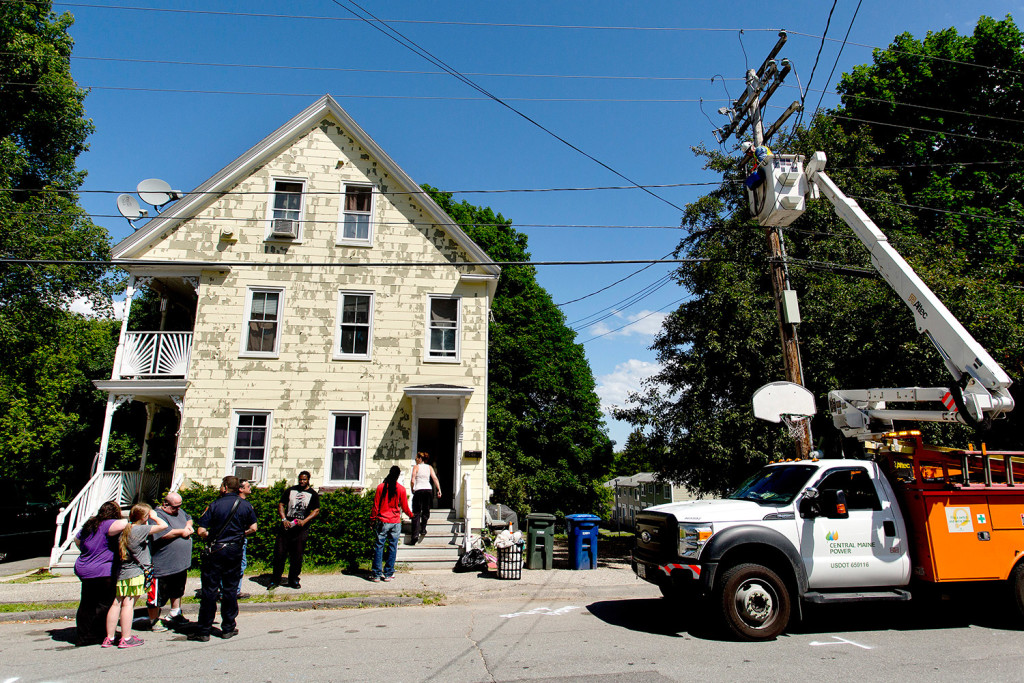 Central Maine Power Co. cuts electricity to the building at 158-160 Brackett St. in Westbrook on Friday after code enforcement officials deemed the building unfit to live in. Gabe Souza/Staff Photographer