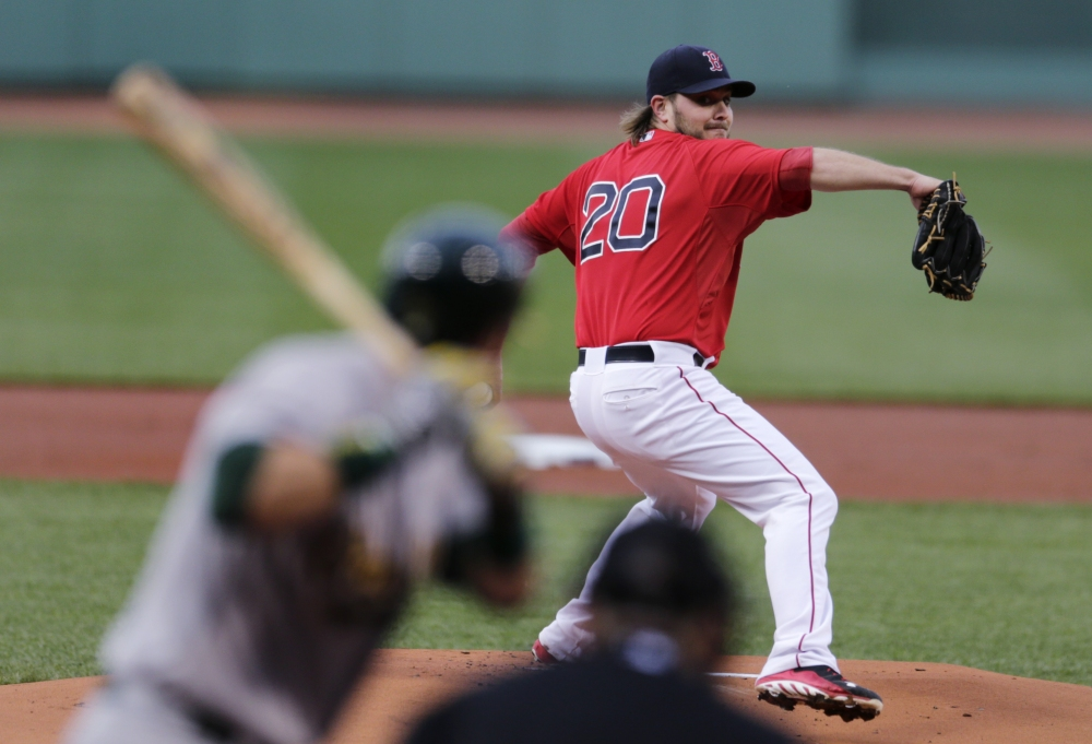 Red Sox starting pitcher Wade Miley delivers in the first inning Friday night against the Oakland Athletics. Miley picked up his fifth win of the season, pitching into the eighth inning.