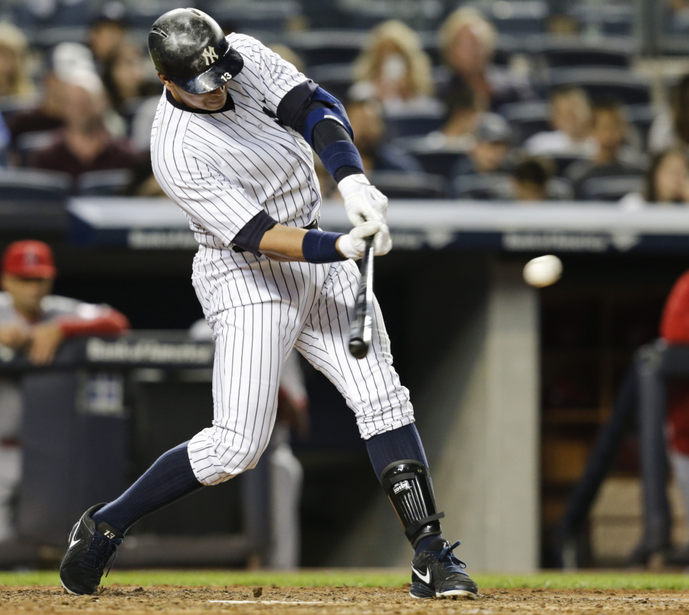 Alex Rodriguez of the Yankees hits an RBI single in the fifth inning against the Angels on Friday night, moving him into second place on the all-time RBI list.