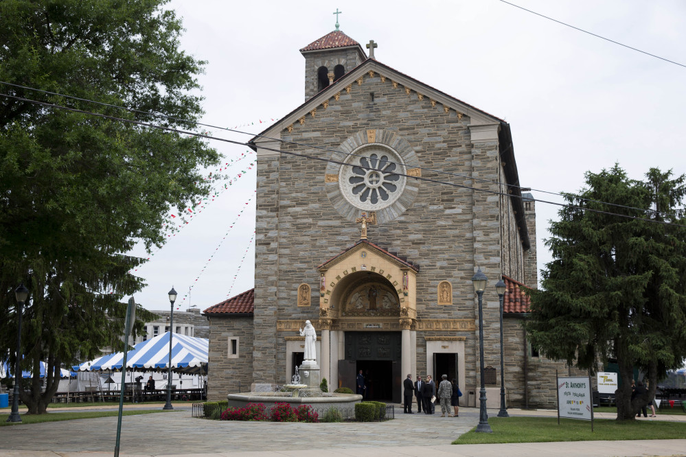 Mourners arrive at St. Anthony of Padua Roman Catholic Church in Wilmington, Del., on Saturday before a funeral for former Delaware Attorney General Beau Biden. Biden, the eldest son of the vice president, died of brain cancer May 30 at age 46.