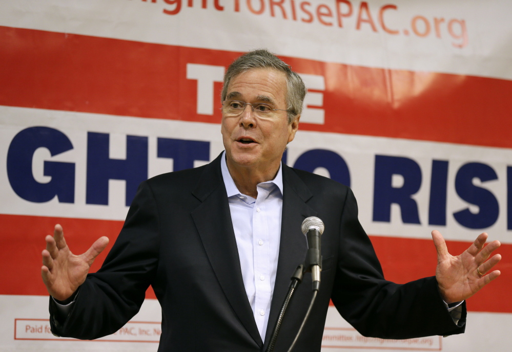 Former Florida Gov. Jeb Bush speaks during a town hall meeting last month at Loras College in Dubuque, Iowa. His central political challenge is how far to distance himself from his family's political legacy. The Associated Press