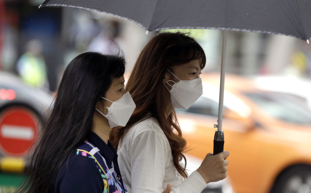 Tourists wear masks as a precaution against Middle East respiratory syndrome Friday in Seoul, South Korea. Four people have died from the outbreak in the nation so far.