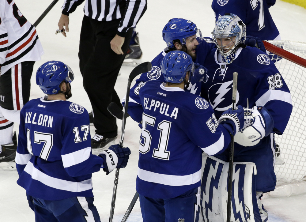 Tampa Bay Lightning players greet backup goalie Andrei Vasilevskiy after their win against the Chicago Blackhawks in Game 2 of the Stanley Cup Finals on Saturday in Tampa, Fla. The Associated Press