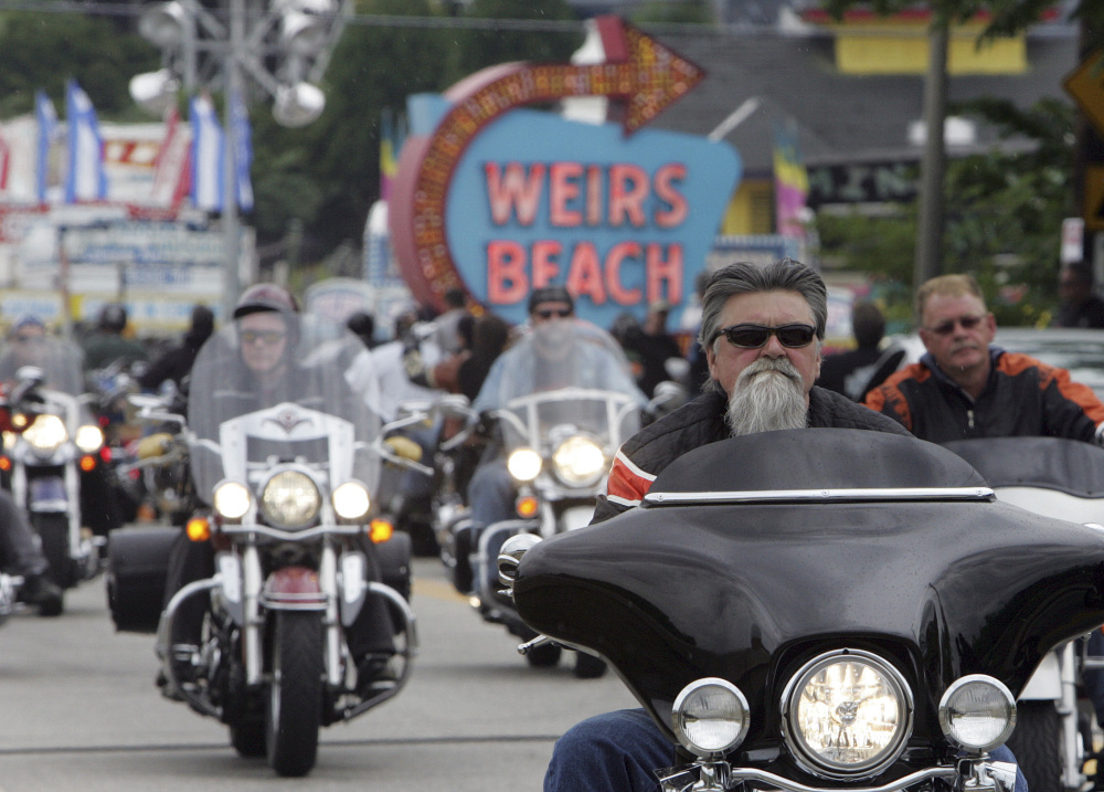 Bikers arrive at Weirs Beach in Laconia, N.H., for bike week in 2010.