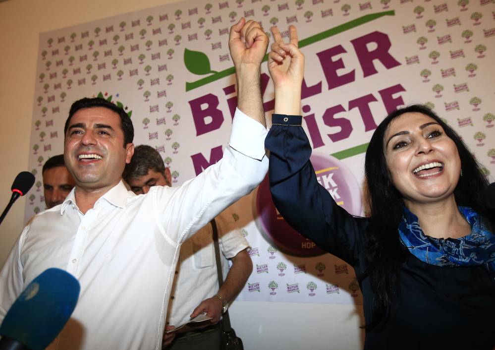 Co-chairs of the pro-Kurdish Peoples' Democratic Party, called HDP, celebrate their new post-election influence in Turkey's government after a Sunday press conference in Istanbul.