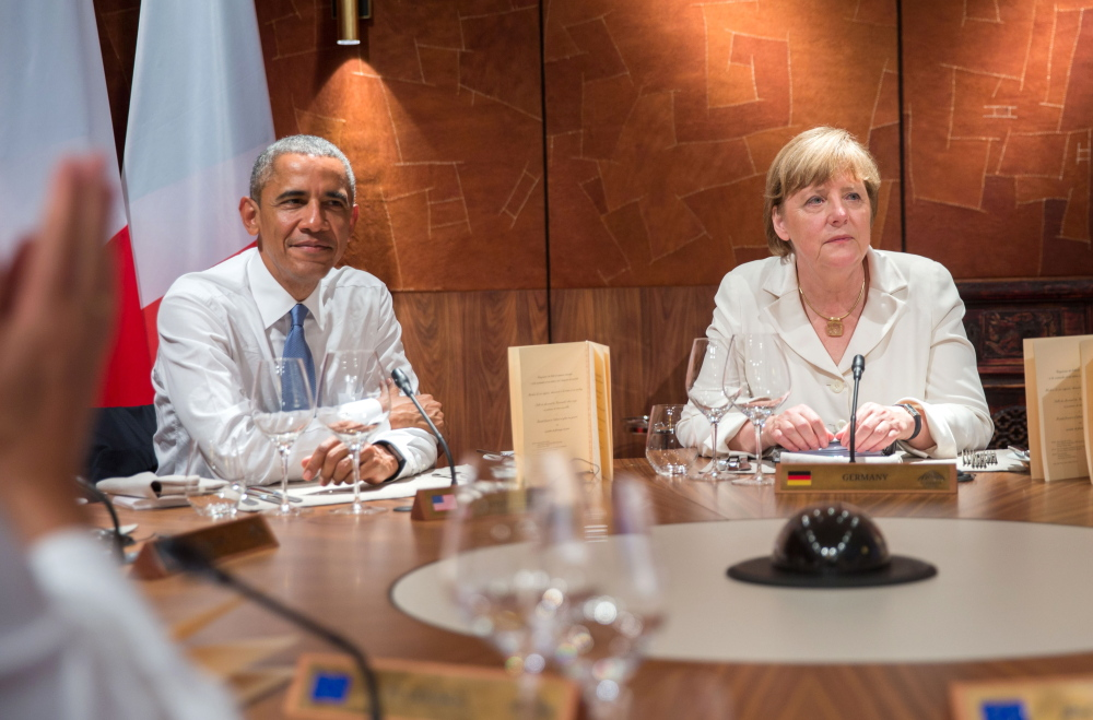 President Obama and German Chancellor Angela Merkel attend a working dinner at the G-7 summit in Elmau near Garmisch-Partenkirchen, southern Germany, on Sunday.