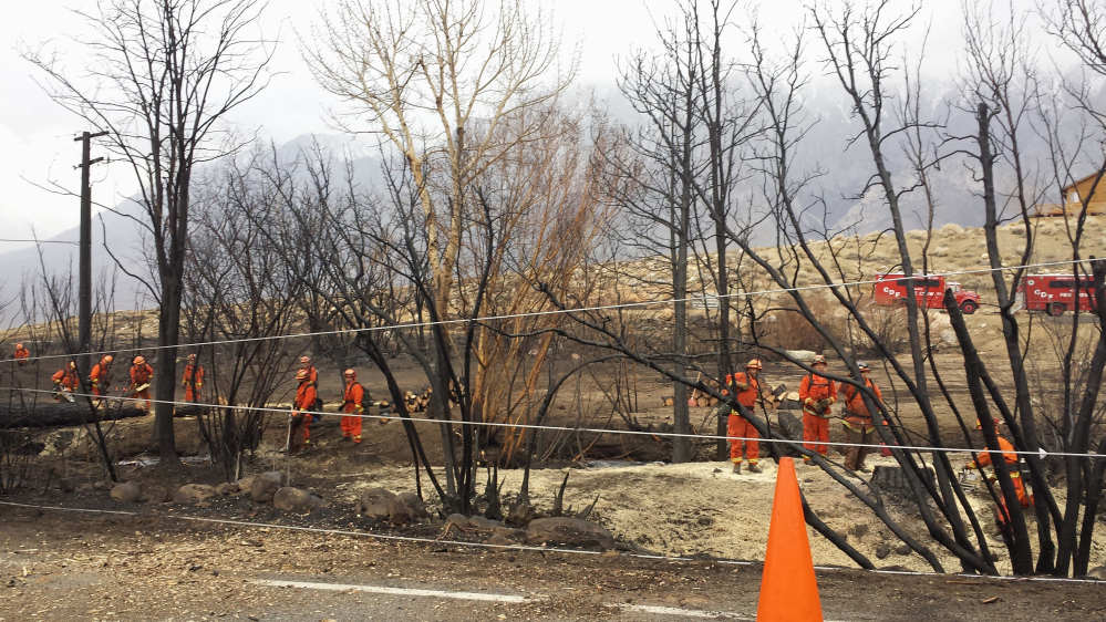Crews of inmate workers clear charred trees along the road near Swall Meadows, Calif., after a wildfire destroyed 40 homes and buildings. Republican lawmakers say more aggressive timbering would make for a healthier forest and improve rural economies.