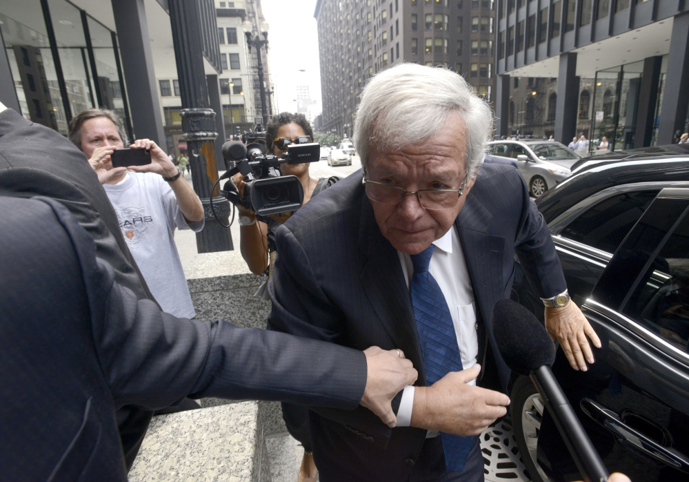Former House Speaker Dennis Hastert arrives at the federal courthouse Tuesday in Chicago for his arraignment on federal charges that he broke federal banking laws and lied about the money when questioned by the FBI.