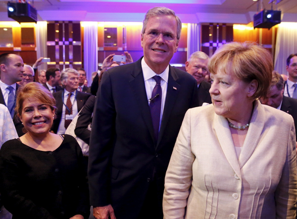 Jeb Bush with his wife Columba, left, and German Chancellor Angela Merkel attend the Christian Democratic Union economic council in Berlin Tuesday.