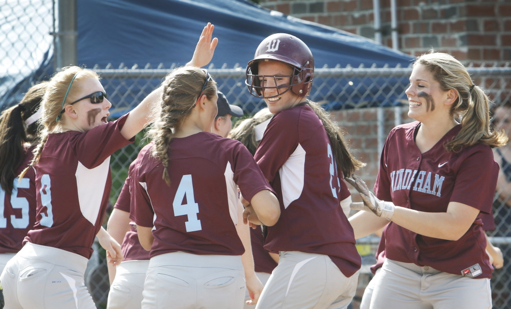 June 9: Windham #24 Sadie Nelson is congratulated by teammates after hitting a home run in the third inning vs. Gorham softball at Windham playoff game Tuesday, June 9, 2015.  Jill Brady/Staff Photographer