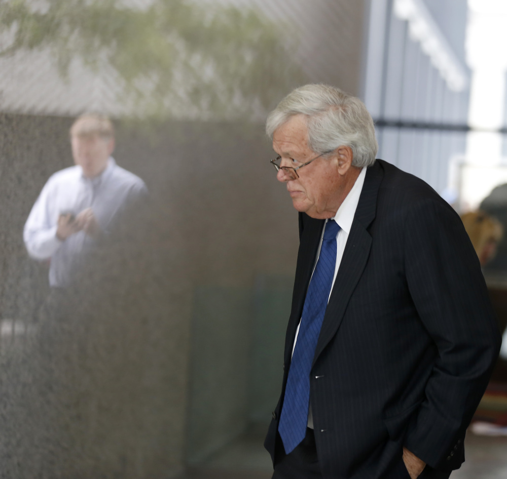 Former House Speaker Dennis Hastert, arrives at the federal courthouse Tuesday, June 9, 2015, in Chicago for his  arraignment on federal charges that he broke federal banking laws and lied about the money when questioned by the FBI. The indictment two weeks ago alleged Hastert agreed to pay $3.5 million to someone from his days as a high school teacher not to reveal a secret about past misconduct. (AP Photo/Christian K. Lee)