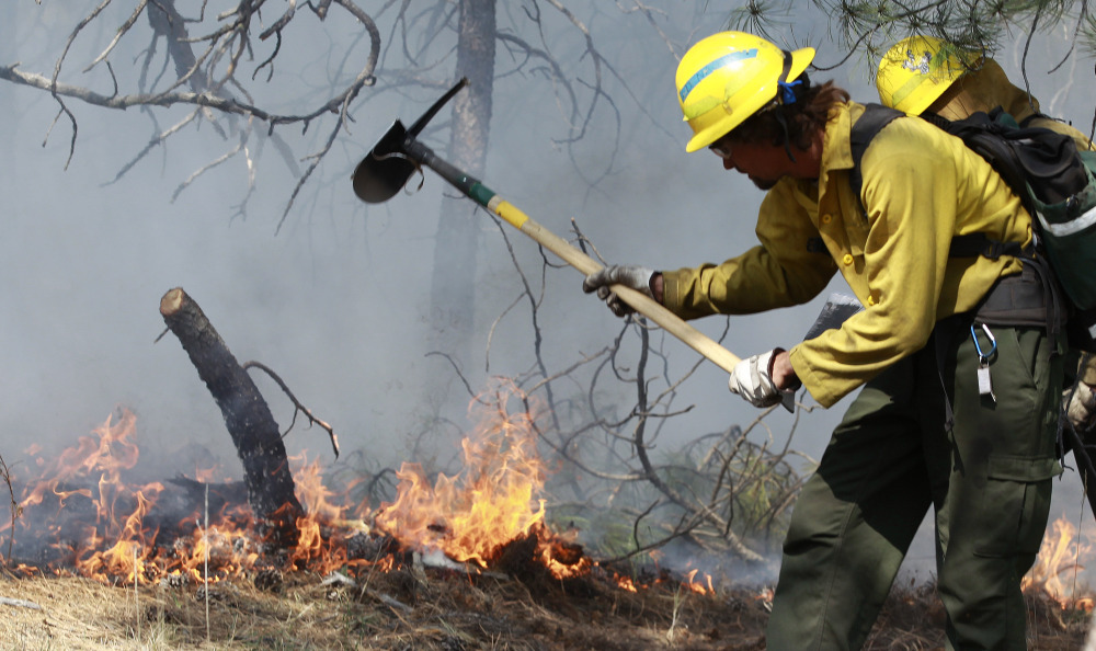 The Obama administration wants to use federal disaster funds to fight costly wildfires like this one in Colorado.