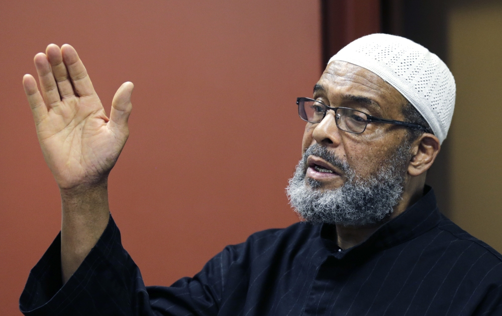 "Imam Abdullah Faaruuq answers a question regarding the shooting of Usaama Rahim by law enforcement, during a news conference at the Black Community Information Center in the Roxbury neighborhood of Boston, Tuesday, June 9, 2015. The Muslim leader says video of the man being fatally shot by terror investigators shows authorities were ""reckless and ""dangerous"" in their actions. Faaruuq is a leader of the Mosque for the Praising of Allah in Boston, where Usaama Rahimand his family prayed. (AP Photo/Charles Krupa)"