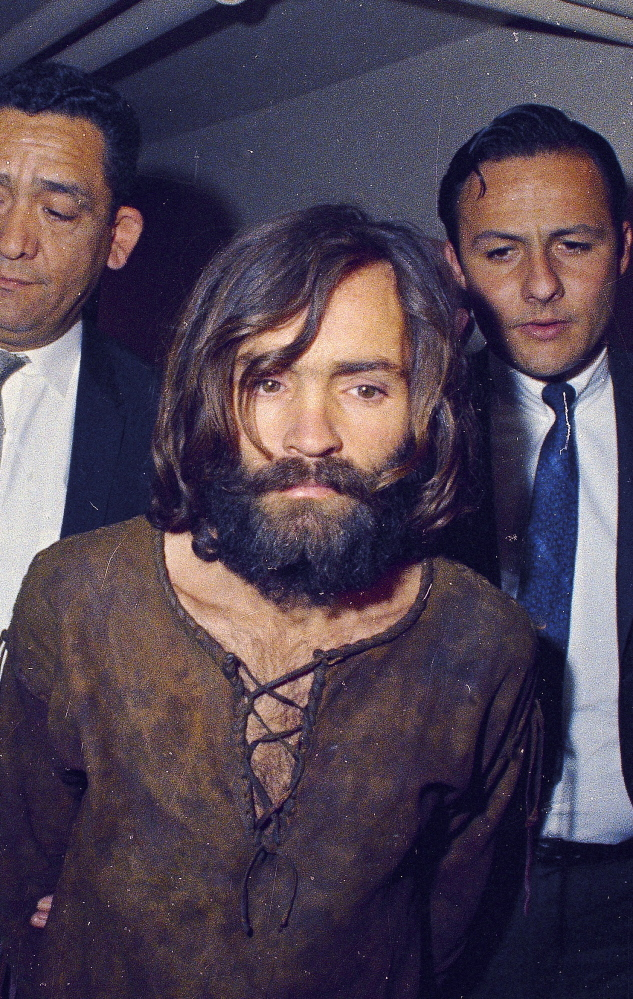 Charles Manson, shown being led to his arraignment in 1969, remains in prison decades after the slayings that shocked the nation.