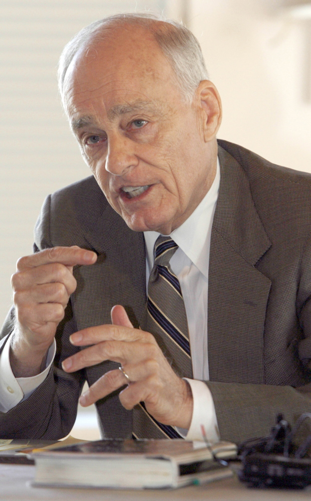 "Vincent Bugliosi speaks at a 2008 news conference in Burlington, Vt. The prosecutor in the Charles Manson trial who went on to write the best-selling true-crime book ""Helter Skelter"" has died. (AP Photo/Toby Talbot, File)"