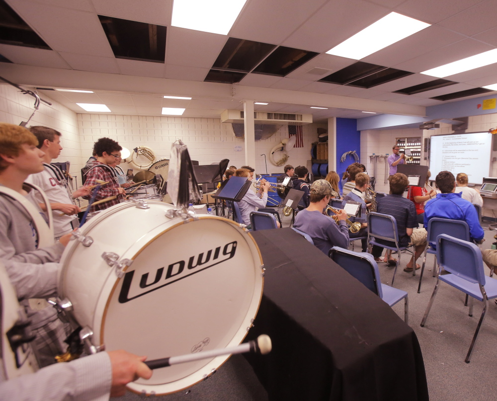 Part of the Kennebunk High School band rehearses in the band room at the school. Voters passed a $56.5 million bond Tuesday for a series of renovations that will give the band enough space to practice together, among other projects in three schools in RSU 21.
