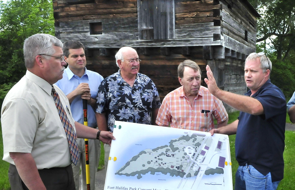 Winslow officials and committee members discuss the Fort Halifax improvement project that will begin this summer. The $193,000 project will include relocation of the parking lot and trails to enhance the historic site. From left are Town Manager Mike Heavener, Jim Bourgoin, Ken Fletcher, Gerald St. Amand and Ray Caron.