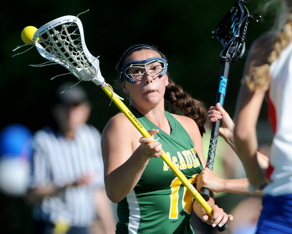 McAuley's Elizabeth Poulin tries to take control of the ball as Messalonskee defenders close in during the first half of an Eastern Class A quarterfinal game Wednesday at Thomas College in Waterville. Messalonskee won, 14-4.