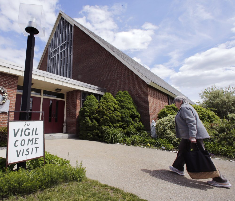 Protesters want the Archdiocese of Boston to either restore the parish's standing at the former St. Frances Cabrini Church in Scituate, Mass., or let them purchase the building outright.