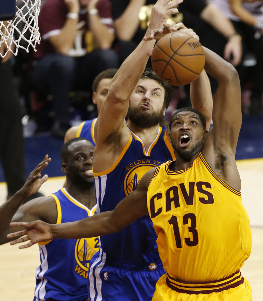 The series is still up for grabs, just like the ball that Golden State Warriors center Andrew Bogut and Cleveland Cavaliers center Tristan Thompson battled for during the second half of Tuesday's game, won by Cleveland.
