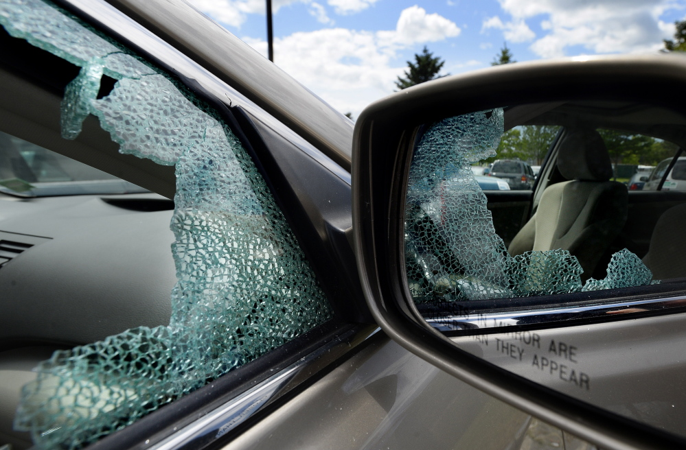 A car parked at the park-and-ride on Marginal Way in Portland on Wednesday has a broken window. There has been a string of recent car burglries in Portland, but overall, the increase over last year is slight.