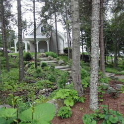 Watch for ways gardeners deal with uneven ground, such as on this property on the Boothbay tour.