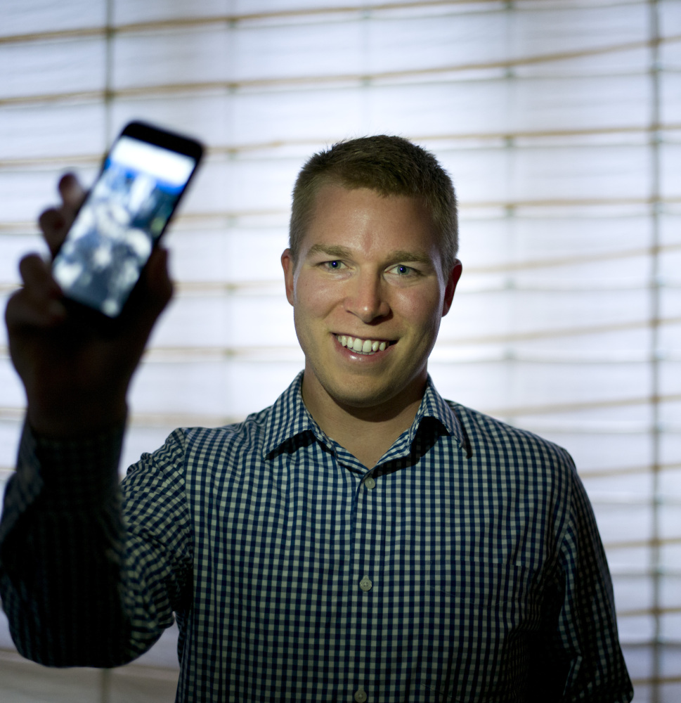 Dan Estes, a Los Angeles real estate broker, shows the app that he built to record the time and place of water-wasting.
