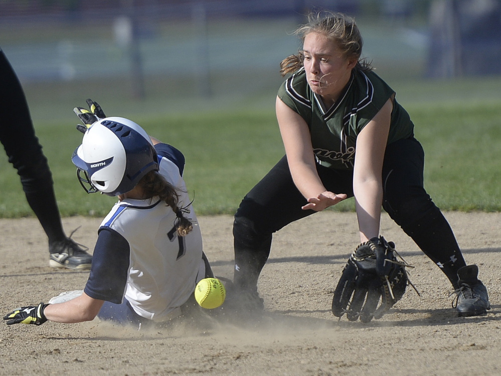 Colleen Sullivan of Yarmouth slides safely into second for a stolen base as Leavitt's Kassie Murch fields the throw Thursday during their Western Class B softball quarterfinal. Yarmouth won, 6-0.