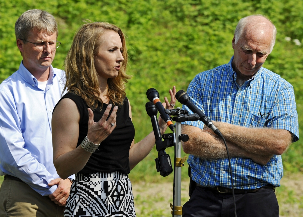Corinne Maleski speaks about her late brother, Keith Broomfield, flanked by her oldest brother, Andrew Broomfield, 38, left, and father, Thomas Broomfield, in Bolton, Mass., on Thursday. Keith Broomfield died fighting with Kurdish forces against the Islamic State group in Syria.