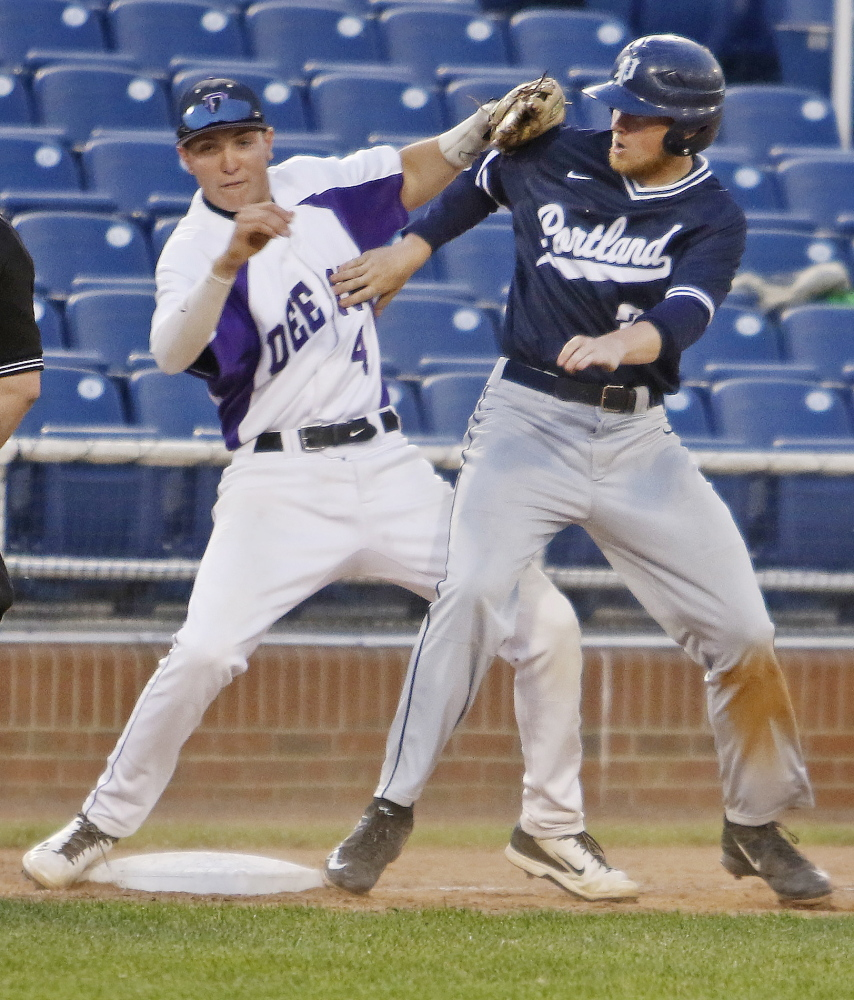 Deering third baseman James Sinclair collides with John Williams of Portland during the fifth inning of top-ranked Portland's 4-3 victory Thursday night in a Western Class A quarterfinal at Hadlock Field. The ball got away on the play and Fortin was able to score.