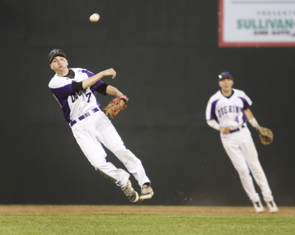 Nick Bevilacqua of Deering fires to first base to end the sixth inning. Portland will take a 13-4 record to the semifinals, while ninth-seeded Deering ended its season at 11-7. Jill Brady/Staff Photographer