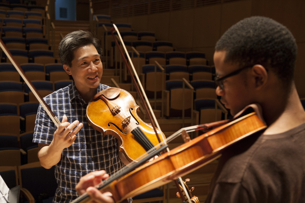 Co-artistic director Phillip Ying works with a student at the Bowdoin International Music Festival.