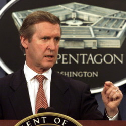 "Secretary of Defense William Cohen answers questions during a news conference in 2001. Above right, Cohen as a member of the Bowdoin College basketball team. He saw himself solidly in the ""jock"" category until he was forced to write a sonnet and discovered a love of writing."