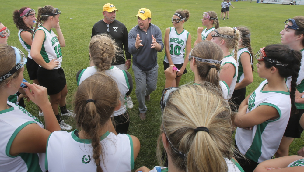 Coach Brooks Bowen, left, and assistant coach Jason Tremblay believed in the winter of 2003-04 that Massabesic High should have a girls' lacrosse program. Though they knew little about the sport, they grew with the program, and now the Mustangs are the team to beat – again.