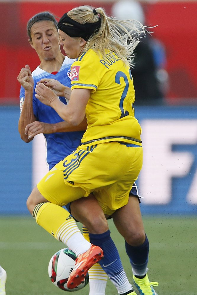 The United States' Carli Lloyd (10) and Sweden's Elin Rubensson collide during the first half of Friday's Women's World Cup match in Winnipeg, Manitoba. The teams finished in a scoreless tie.